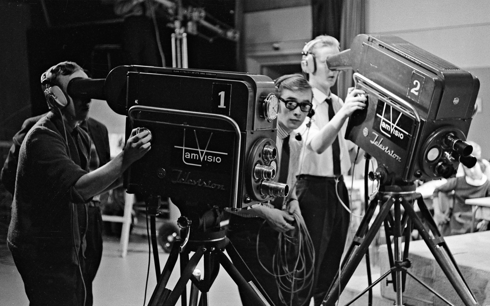 Camera operators from 1950s using three lens cameras
